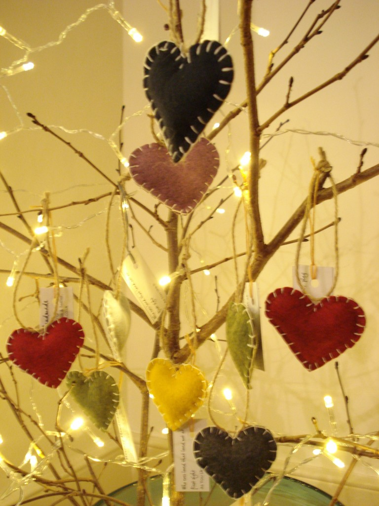 Heart on a string.  Felt stuffed hearts on garden twine, cute in the tree, cute on a doorknob.