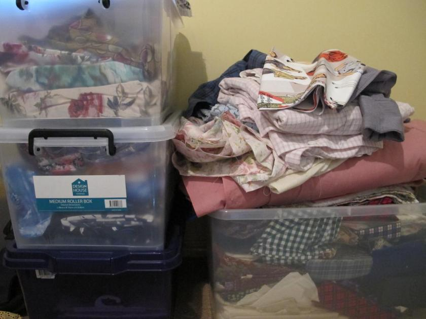 The patchwork fabric pile (on the right)