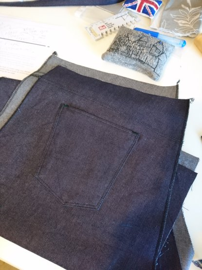 Pockets on, topstitching and overlocking done